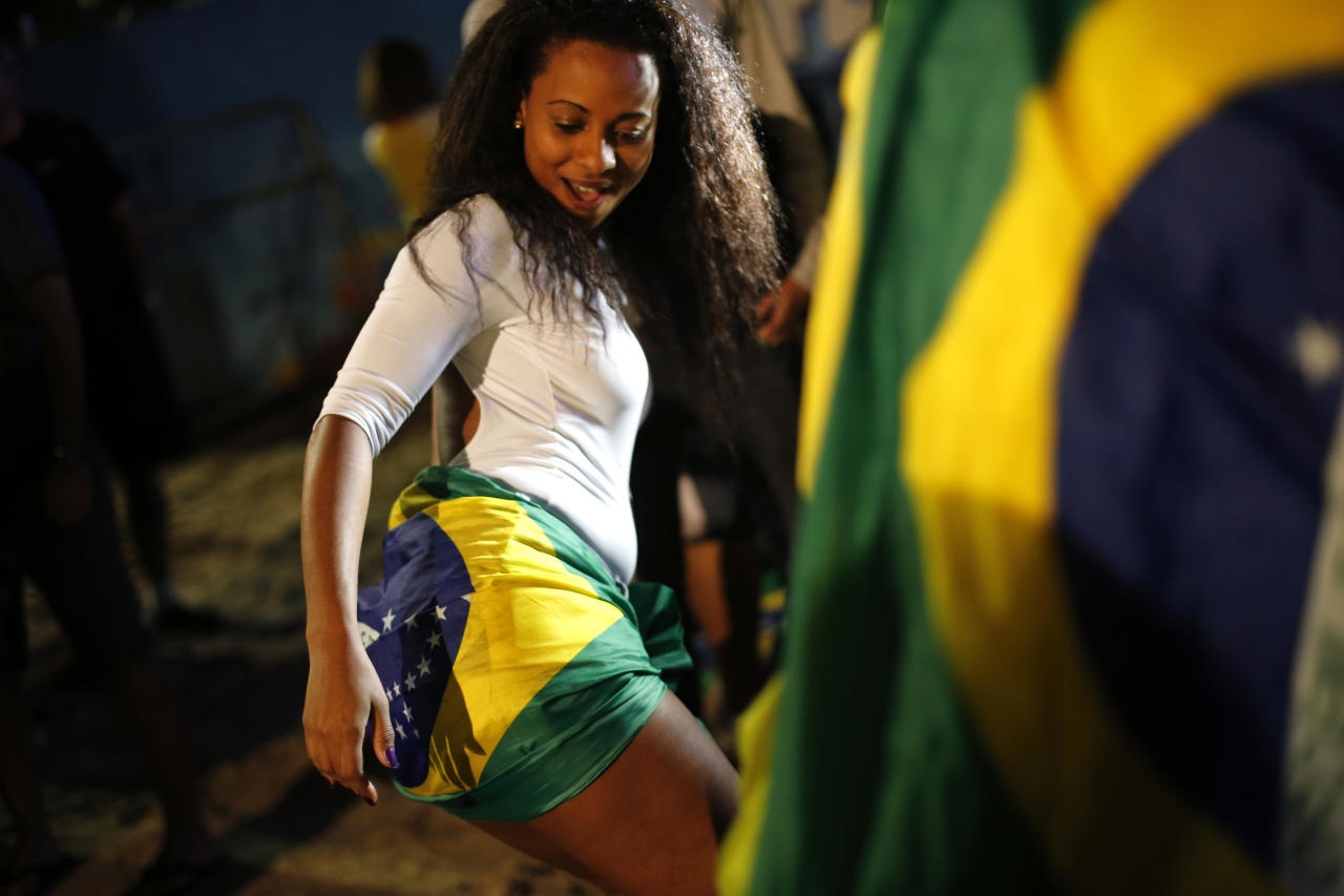 A fan of the Brazil national soccer team dances after a live broadcast of the World Cup third-place soccer match between Brazil and Netherlands, inside the FIFA Fan Fest area on Copacabana beach, Rio de Janeiro, Brazil, Saturday, July 12, 2014. Robin van Persie and Daley Blind scored early goals to help give the Netherlands a 3-0 win over host Brazil in the third-place match at the World Cup. (AP Photo/Silvia Izquierdo)