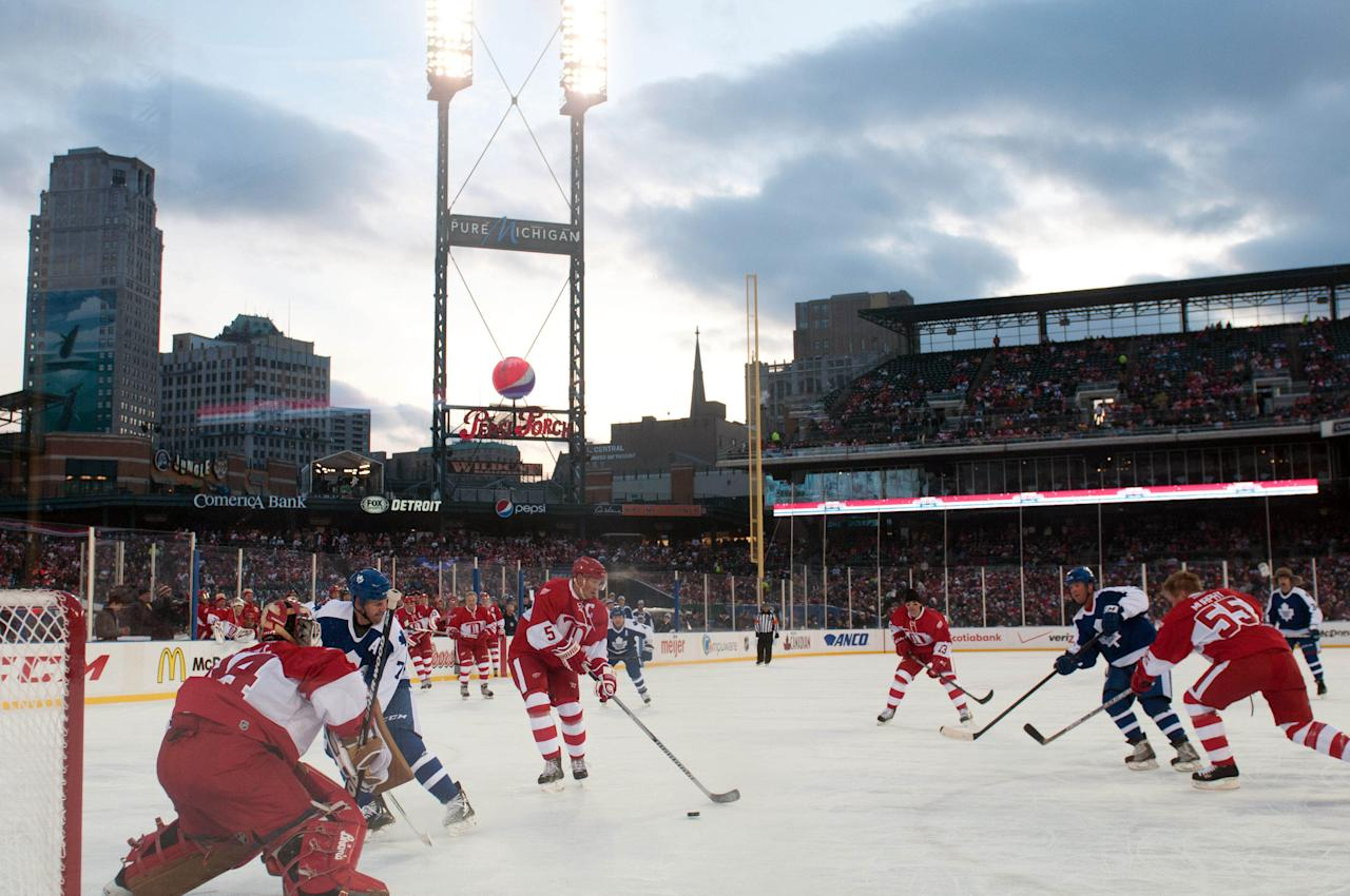 Dec 31, 2013; Detroit, MI, USA; Detroit Red Wings former forward Nicklas Lidstrom (5) clears the puck during the Alumni Showdown against the Toronto Maple Leafs as part of the Winter Classic at Comerica Park. (Tim Fuller-USA TODAY Sports)