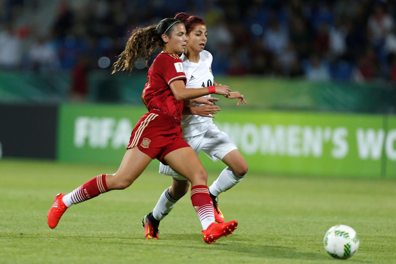 Football Soccer - Jordan vs Spain - U-17 Women's World Cup - Amman, Jordan - 30/9/16 Spain's Berta Pujadas (L), fights for the ball with Jordan's Sarah Abu-Sabbah, during the match. REUTERS/Muhammad Hamed