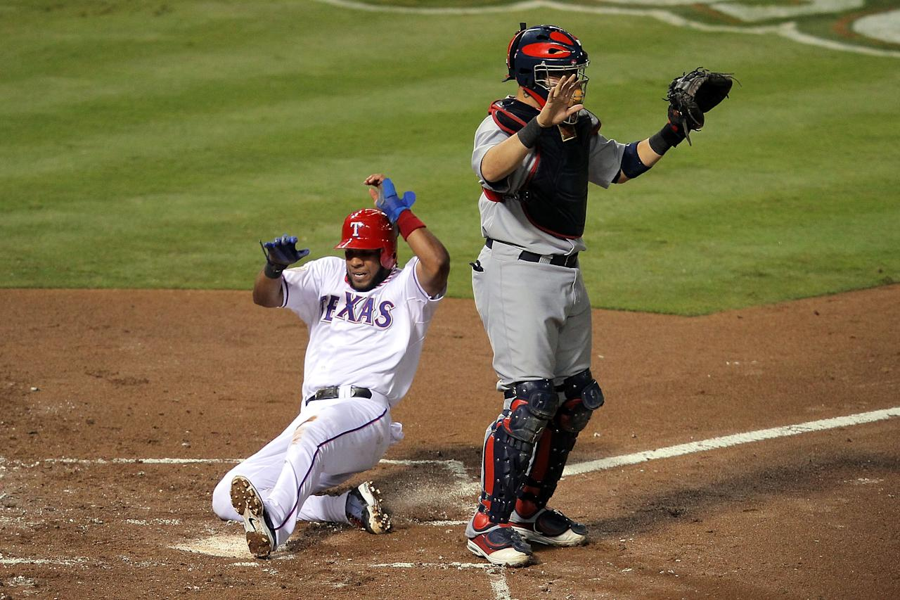 ARLINGTON, TX - OCTOBER 23:  Elvis Andrus #1 of the Texas Rangers scores in the first inning after a Josh Hamilton #32 RBI double in front of Yadier Molina #4 of the St. Louis Cardinals during Game Four of the MLB World Series at Rangers Ballpark in Arlington on October 23, 2011 in Arlington, Texas.  (Photo by Doug Pensinger/Getty Images)