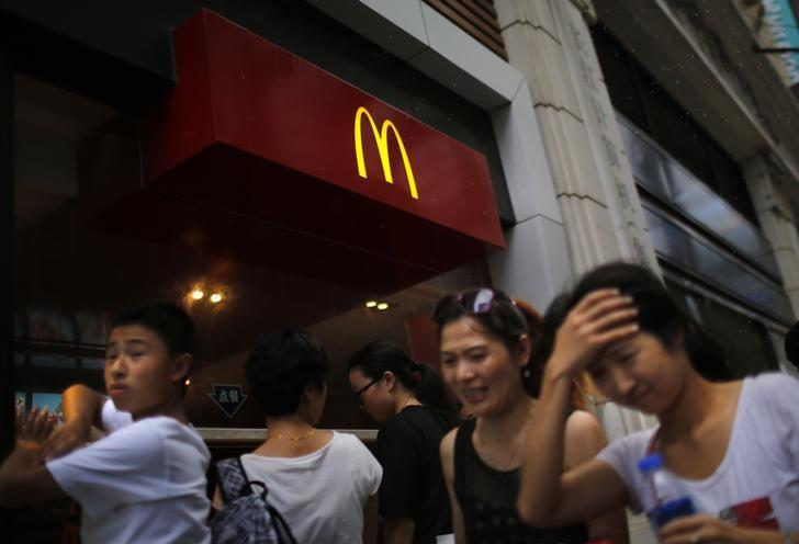 People walk by a McDonald's store in downtown Shanghai