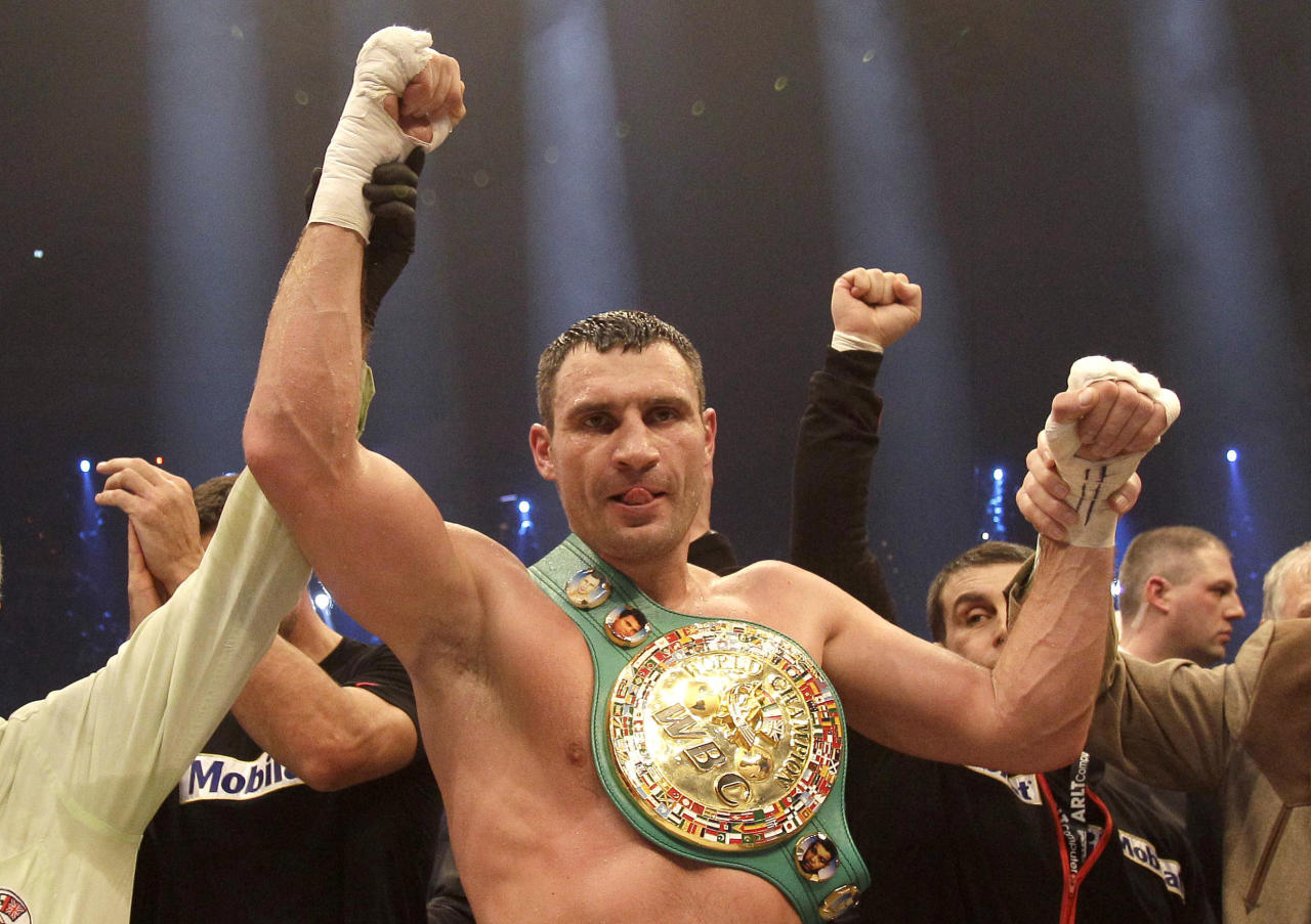 WBC heavyweight Champion Vitali Klitschko of Ukraine celebrates after winning the WBC heavyweight title boxing bout against boxer Dereck Chisora of Britain at the Olympic hall in Munich, Germany, Sunday, Feb. 19, 2012. (AP Photo/Frank Augstein)