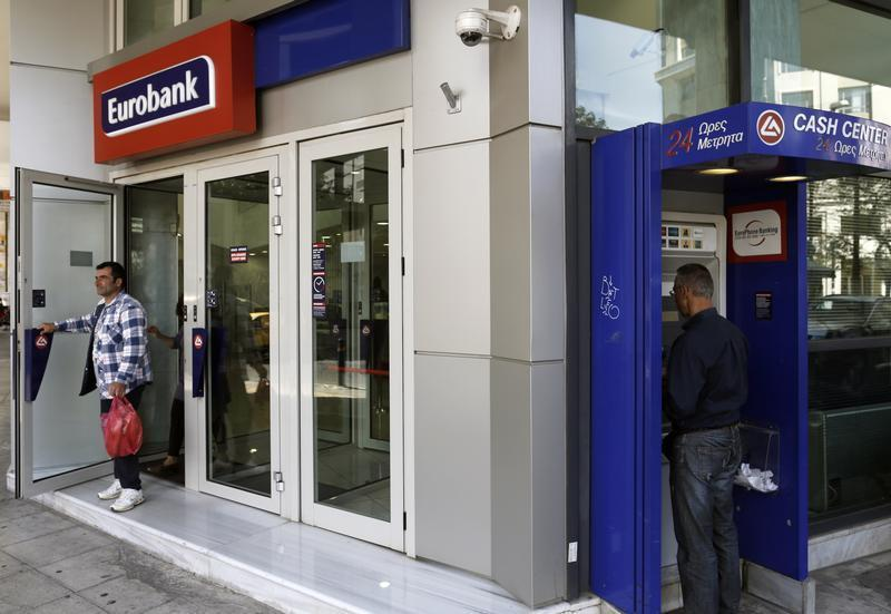 A customer leaves a Eurobank branch in Athens