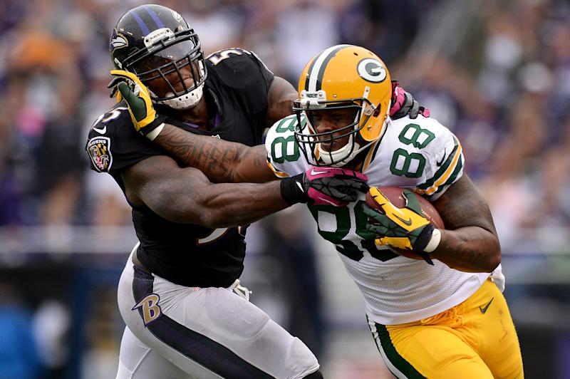 BALTIMORE, MD - OCTOBER 13: Tightend Jermichael Finley #88 of the Green Bay Packers stiff arms linebacker Terrell Suggs #55 of the Baltimore Ravens in the fourth quarter at M&T Bank Stadium on October 13, 2013 in Baltimore, Maryland. (Photo by Patrick Smith/Getty Images)