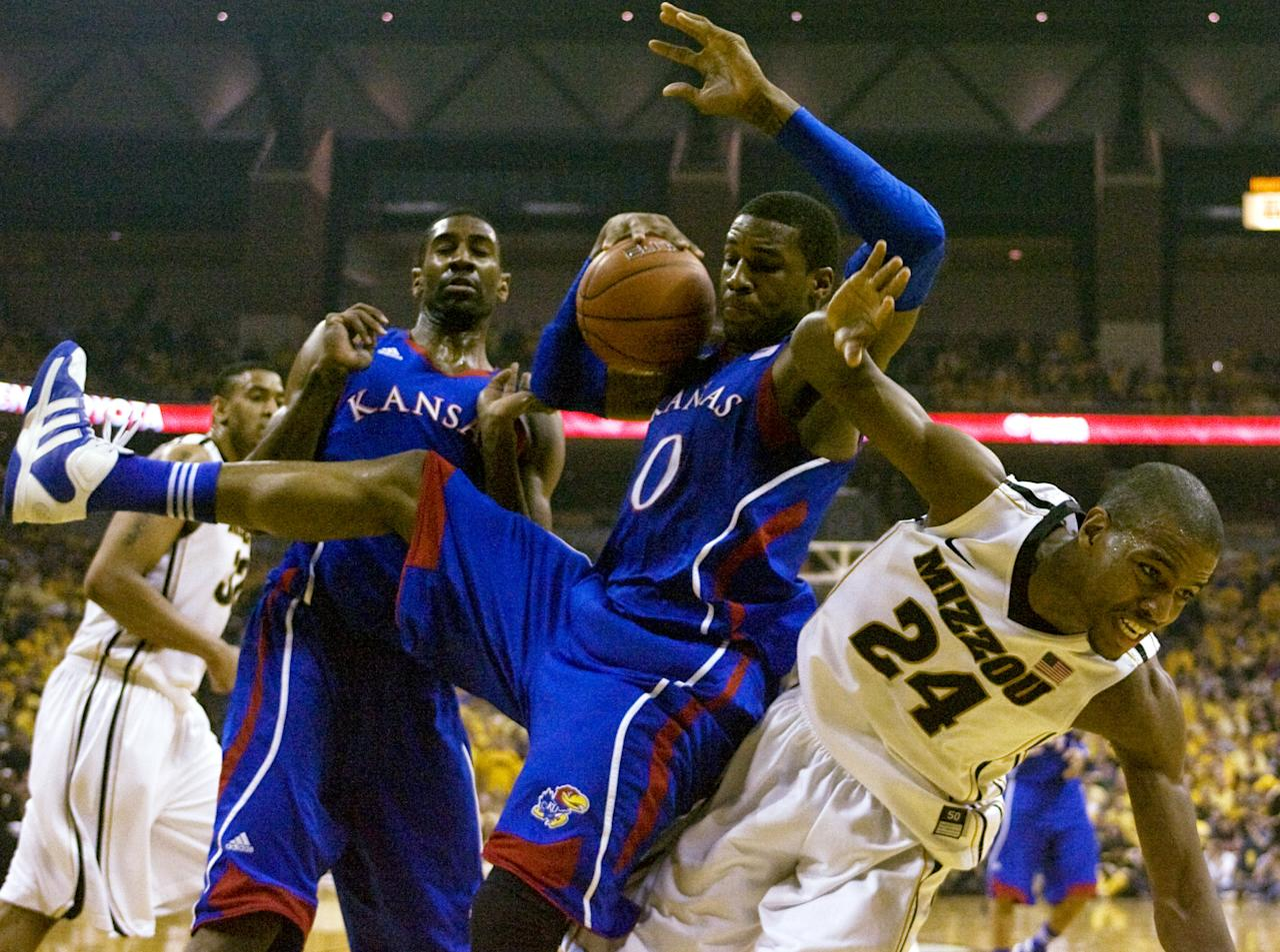 COLUMBIA, MO - FEBRUARY 04:    Thomas Robinson #0 of the Kansas Jayhawks grabs a rebound from Kim English #24 of the Missouri Tigers during the first half at Mizzou Arena on February 4, 2012 in Columbia, Missouri. (Photo by Ed Zurga/Getty Images)