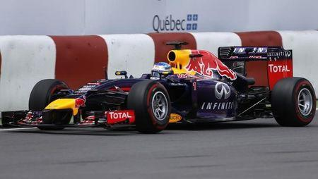 Red Bull Formula One driver Sebastian Vettel of Germany pilots his car next to a barrier during the qualifying session of the Canadian F1 Grand Prix at the Circuit Gilles Villeneuve in Montreal