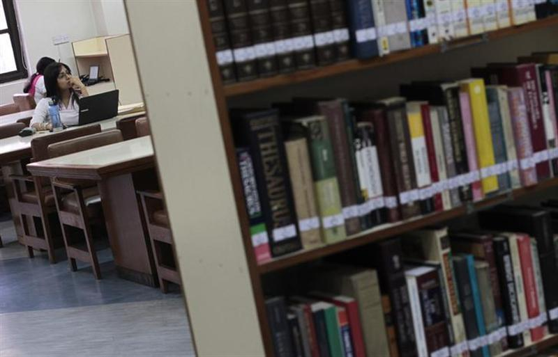 A Master of Business Administration (MBA) student works on a computer in a library at the Management Development Institute (MDI) in Gurgaon, on the outskirts of New Delhi May 2, 2012.