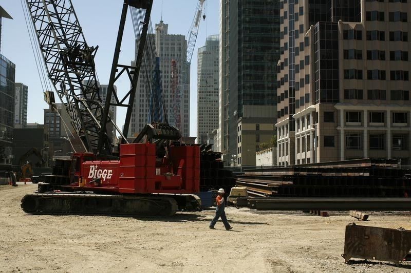 A worker walks through a construction site in San Francisco