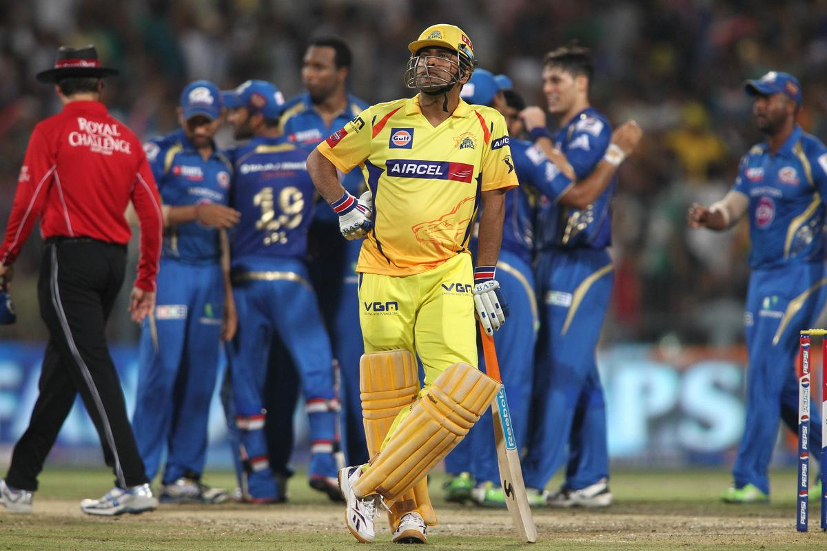 Chennai Super Kings captain MS Dhoni looks on as another wicket falls during the Final of the Pepsi Indian Premier League between The Chennai Superkings and the Mumbai Indians held at the Eden Gardens Stadium in Kolkata on the 26th May 2013..Photo by Saikat Das-IPL-SPORTZPICS       ..Use of this image is subject to the terms and conditions as outlined by the BCCI. These terms can be found by following this link:..http://www.sportzpics.co.za/image/I0000SoRagM2cIEc