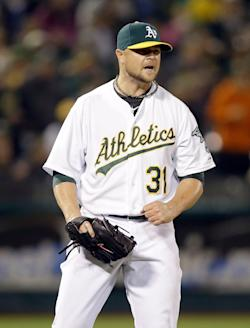 Lester has won all three of his starts since joining the A's. (Getty Images)