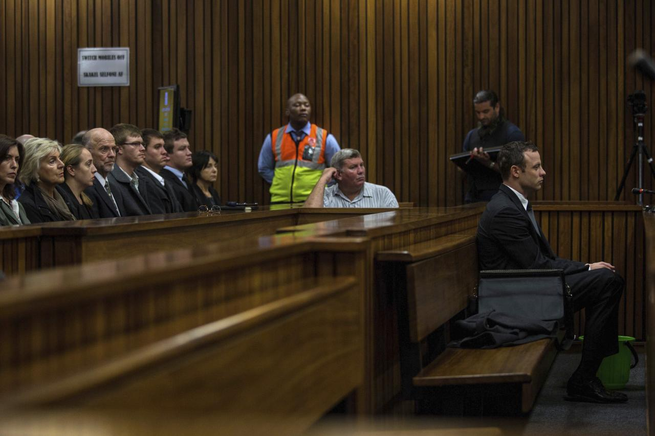 Olympic and Paralympic track star Oscar Pistorius sits in the dock at the North Gauteng High Court in Pretoria March 11, 2014. Pistorius is on trial for the murder of his girlfriend Reeva Steenkamp at his suburban Pretoria home on Valentine's Day last year. REUTERS/Kevin Sutherland/Pool (SOUTH AFRICA - Tags: SPORT CRIME LAW)