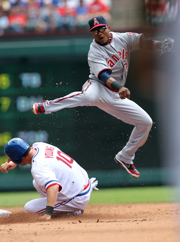 ARLINGTON, TX - MAY 12: Erick Aybar #2 of the Los Angeles Angels of Anaheim turns the double play as Michael Young #10 of the Texas Rangers is out at 2nd base on May 12, 2012 in Arlington, Texas. (Photo by Layne Murdoch/Getty Images)
