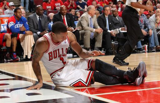 CHICAGO, IL - APRIL 28:  Derrick Rose #1 of the Chicago Bulls sits on the floor after injuring his knee against the Philadelphia 76ers in Game One of the Eastern Conference Quarterfinals during the 2012 NBA Playoffs on April 28, 2012 at the United Center in Chicago, Illinois. (Photo by Gary Dineen/NBAE via Getty Images)