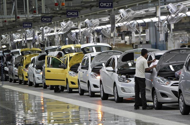 Workers assemble cars inside the Hyundai Motor India Ltd. plant at Kancheepuram district in Tamil Nadu