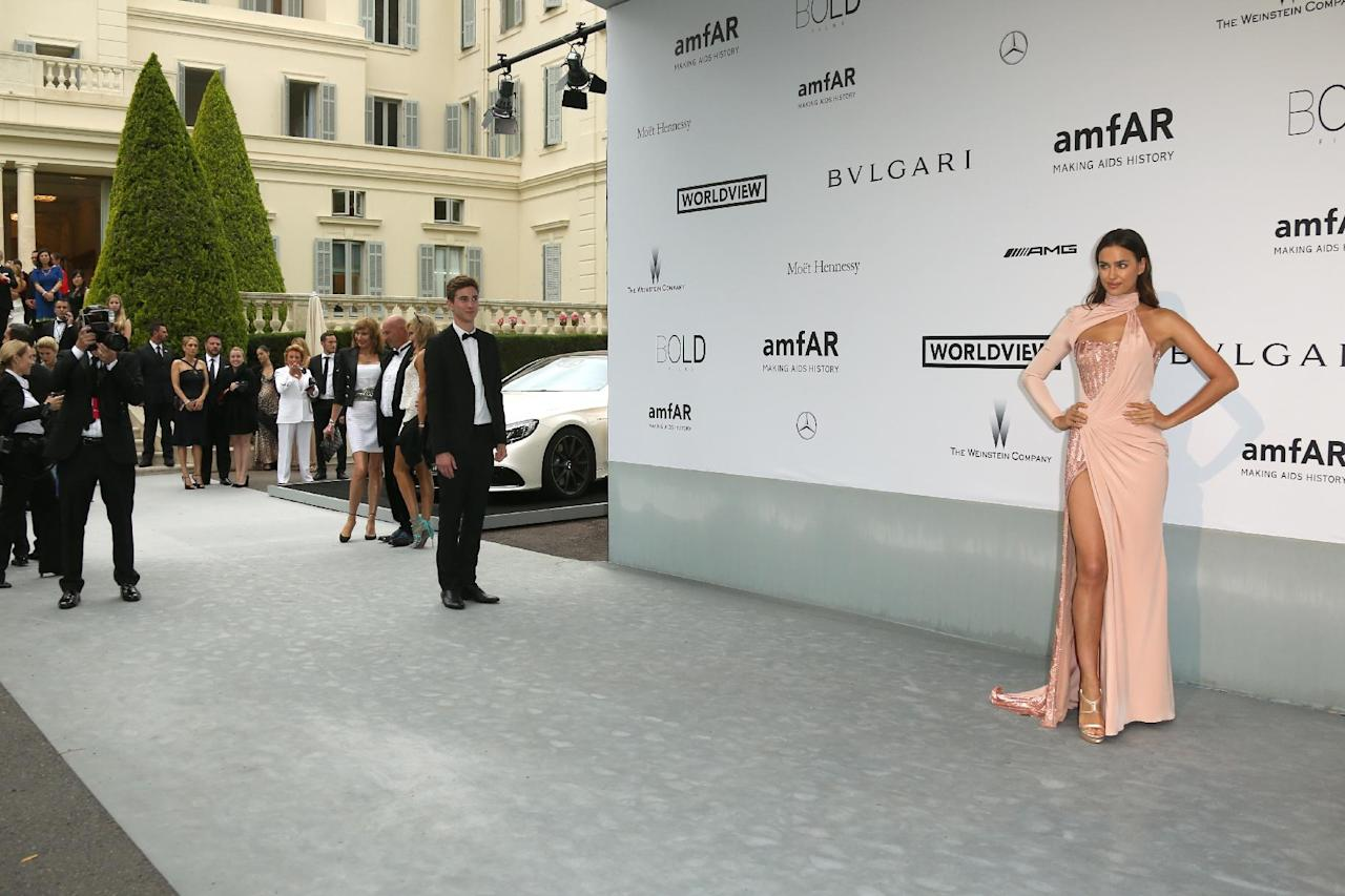 Model Irina Shayk arrives at the amfAR Cinema Against AIDS benefit at the Hotel du Cap-Eden-Roc, during the 67th international film festival, in Cap d'Antibes, southern France, Thursday, May 22, 2014. (Photo by Joel Ryan/Invision/AP)