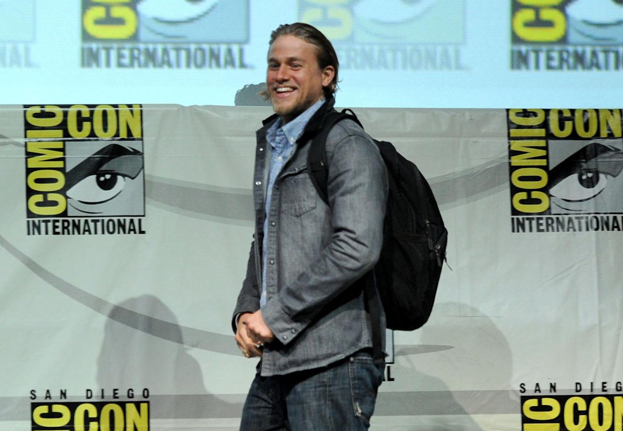 """SAN DIEGO, CA - JULY 21: Actor Charlie Hunnam speaks onstage at the """"Sons Of Anarchy"""" panel during Comic-Con International 2013 at San Diego Convention Center on July 21, 2013 in San Diego, California. (Photo by Kevin Winter/Getty Images)"""