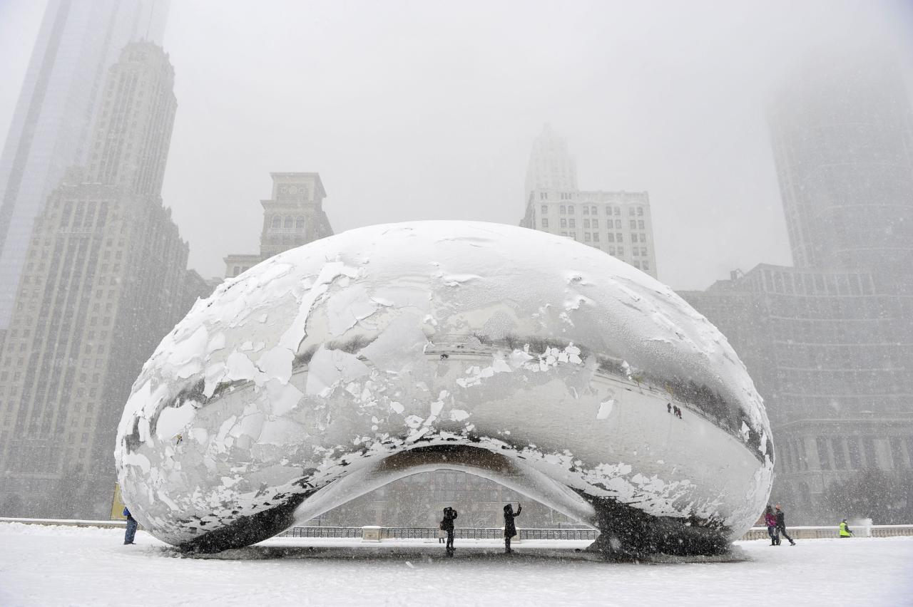 "CHICAGO, IL - MARCH 5:  The sculpture ""Cloud Gate"", commonly known as ""the bean,"" is covered in snow on March 5, 2013 in Chicago, Illinois. The worst winter storm of the season is expected to dump 7-10 inches of snow on the Chicago area with the worst expected for the evening commute.  (Photo by Brian Kersey/Getty Images)"