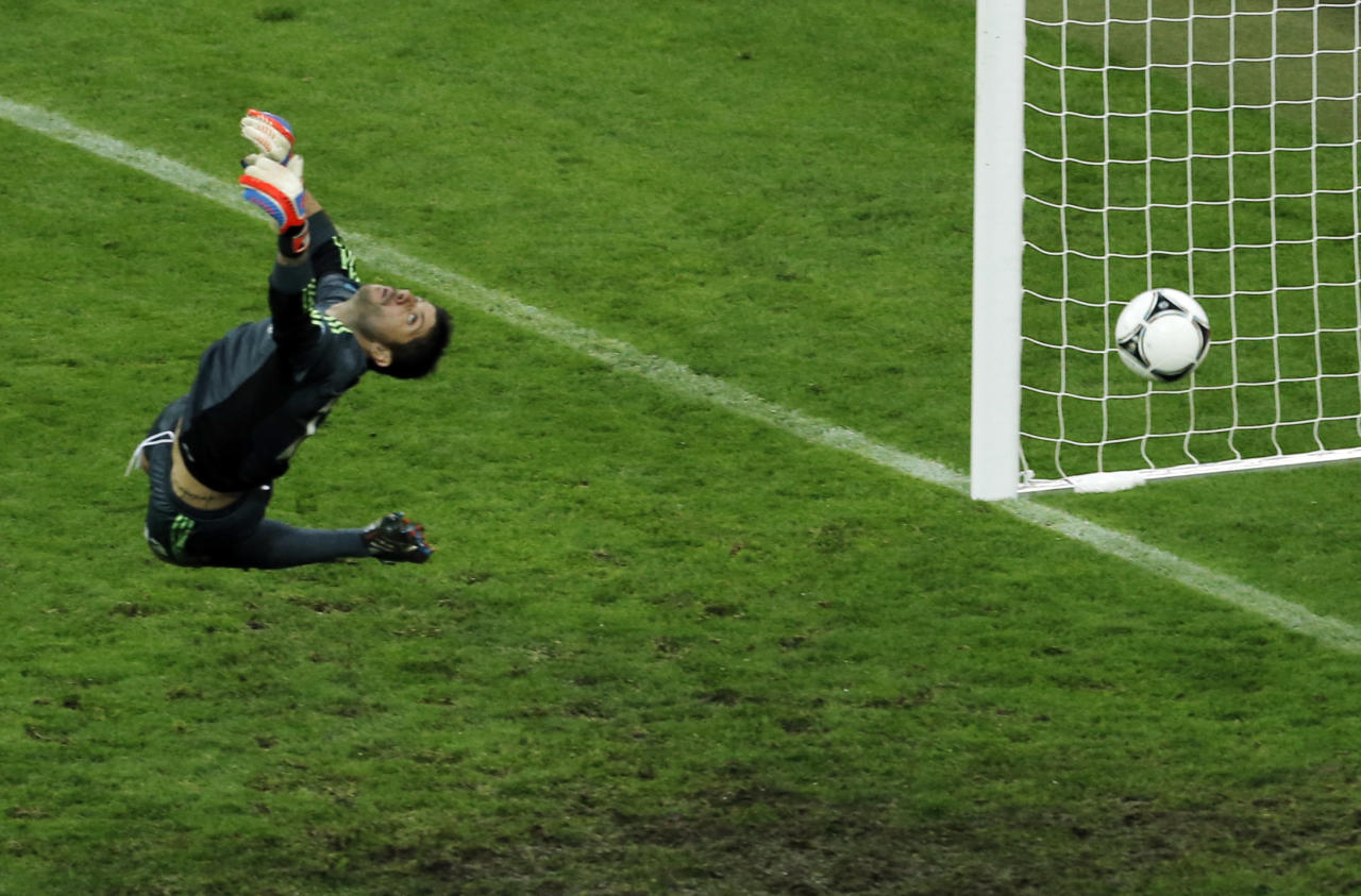Greece goalkeeper Michalis Sifakis fails to make a save as Germany's Philipp Lahm, unseen, scores the opening goal during the Euro 2012 soccer championship quarterfinal match between Germany and Greece in Gdansk, Poland, Friday, June 22, 2012. (AP Photo/Gero Breloer)
