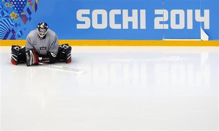Team USA goaltender McLaughlin stretches before their women's ice hockey team practice at the Shayba Arena