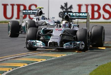 Mercedes Formula One driver Hamilton of Britain drives ahead of Mercedes Formula One driver Rosberg of Germany during the third practice session of the Australian F1 Grand Prix in Melbourne