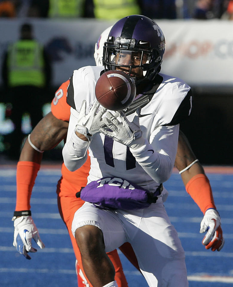 TCU's Skye Dawson (11) holds on to a reception against Boise State during the first half of an NCAA college football game on Saturday, Nov. 12, 2011 in Boise, Idaho. (AP Photo/Matt Cilley)