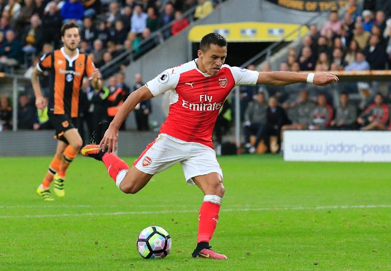 Arsenal's striker Alexis Sanchez shoots and scores during the English Premier League football match between Hull City and Arsenal at the KCOM Stadium on September 17, 2016