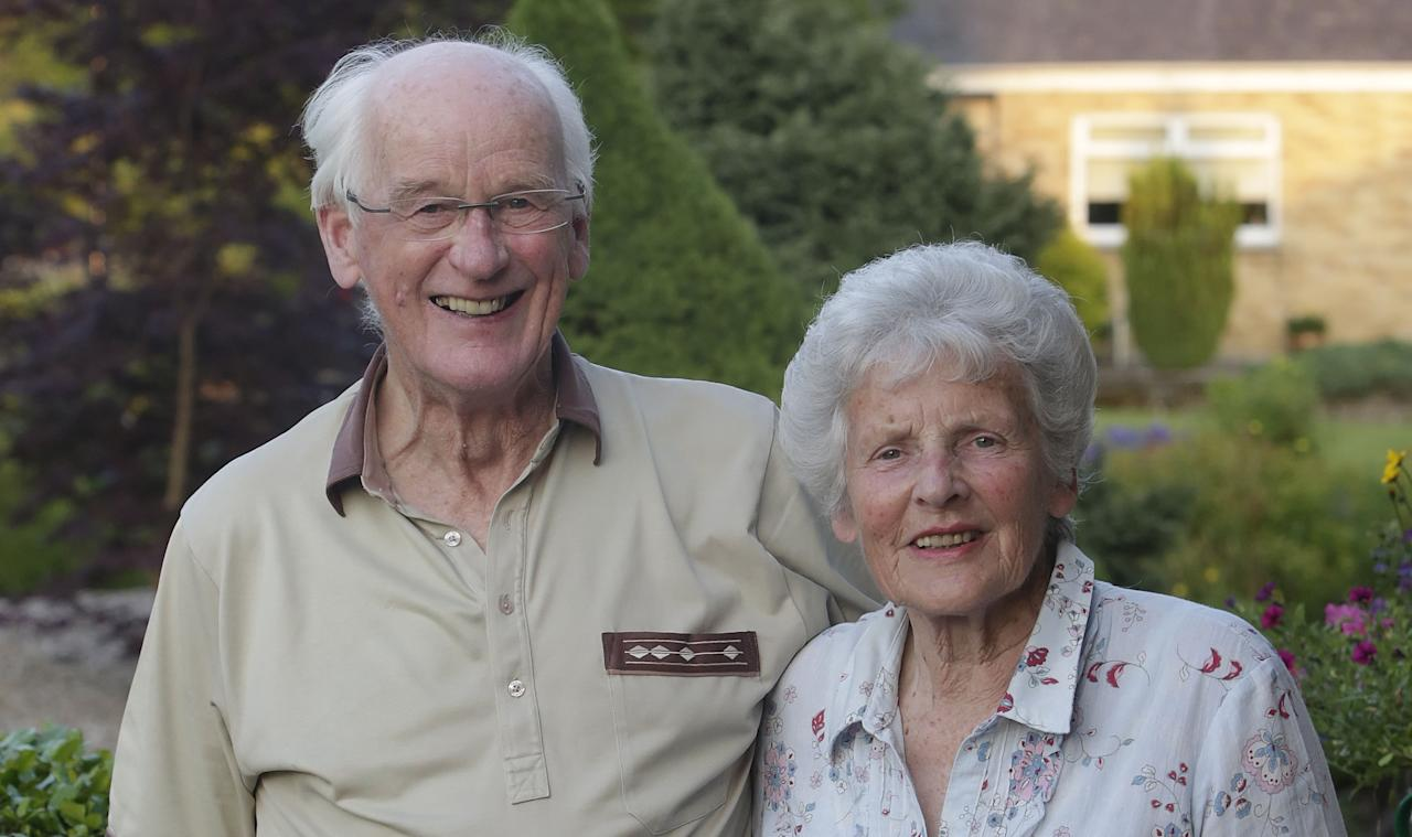 Andy Murray's grandparents Roy and Shirley Erskine celebrate at their home in Dunblane, Scotland, after Murray beat Novak Djokovic to win the Wimbledon final.
