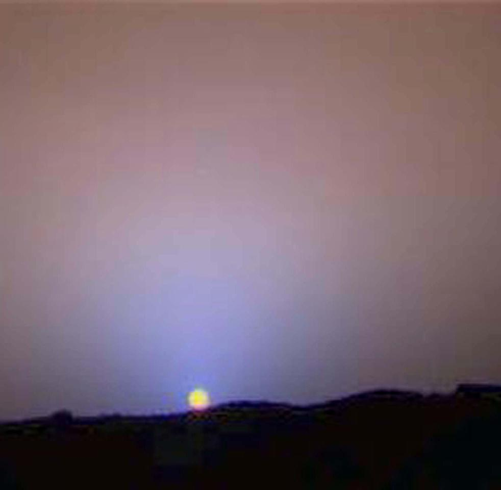 A close-up of the sunset on Sol 24 as seen by the Imager for Mars Pathfinder was released by the Jet Propulsion Labratory August 27. The red sky in the background and the blue around the Sun are approximately as they would appear to the human eye but the color of the Sun itself is not correct -- the Sun was overexposed in each of the 3 color images that were used to make the picture. The true color of the Sun itself may be near white or slightly bluish.