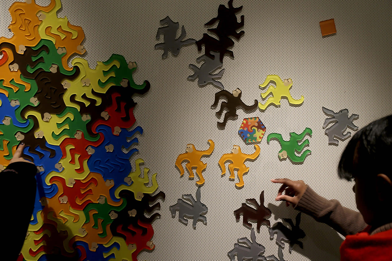 "Students play with interlocking shapes at a ""Tessellation Station"" at the new National Museum of Mathematics."