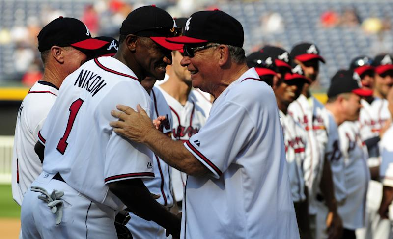 Former Atlanta Braves manager Bobby Cox greets Otis Nixon for a Braves Legends Game (AP Photo/Dave Tulis)