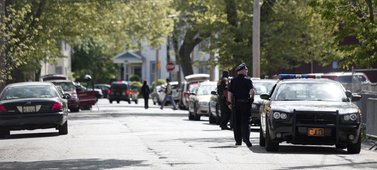 CLEVELAND, OH - MAY 7:  A police officer keeps the public away from the house where three women, who disappeared as teens about a decade ago, were found alive May 7, 2013 in Cleveland, Ohio. Amanda Berry, who went missing in 2003, Gina DeJesus, who went missing in 2004, and Michelle Knight, who went missing in 2002, managed to escape their captors on May 6, 2013. Three suspects, all brothers, were taken into custody.   (Photo by Bill Pugliano/Getty Images)