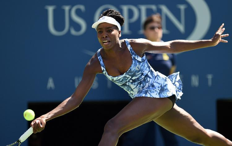Venus Williams of the US returns to Kimiko Date-Krumm of Japan during their US Open 2014 women's singles match at the USTA Billie Jean King National Center August 25, 2014 in New York