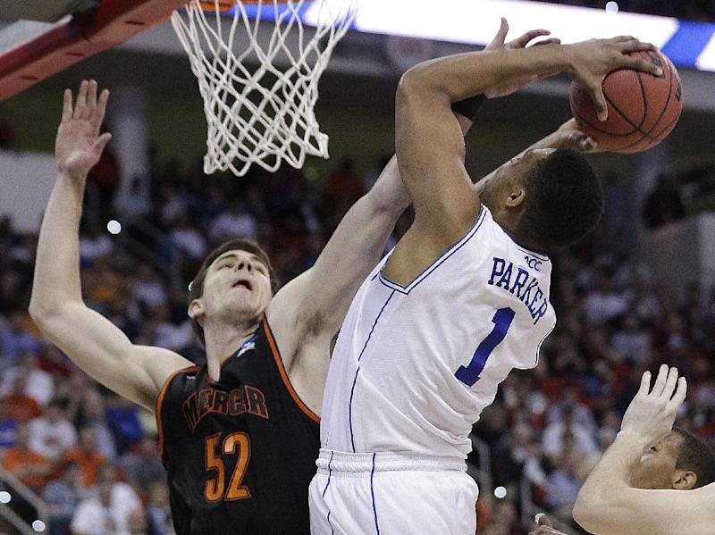 Duke forward Jabari Parker (1) shoots over Mercer forward Daniel Coursey (52) during the second half of an NCAA college basketball second-round game, Friday, March 21, 2014, in Raleigh, N.C