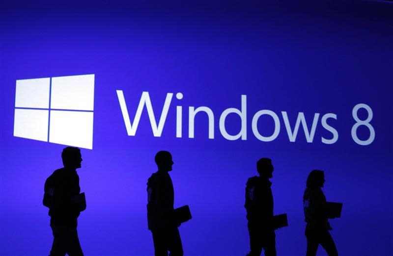 File photo of guests silhouetted at the launch event of Microsoft Windows 8 operating system in New York
