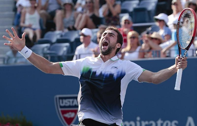 Marin Cilic reacts after defeating Tomas Berdych on Thursday. (AP)