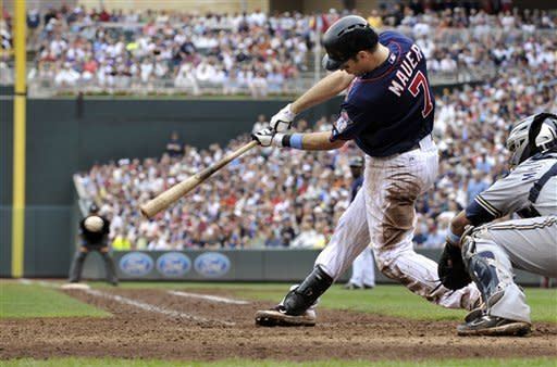 Span has RBI single in 15th; Twins beat Brewers