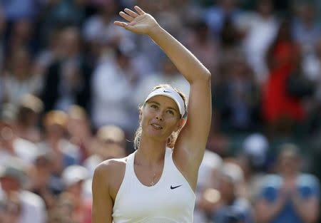 Maria Sharapova of Russia waves after defeating Samantha Murray of Britain in their women's singles tennis match at the Wimbledon Tennis Championships, in London
