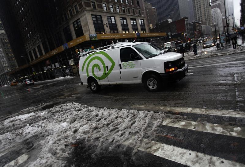 A Time Warner Cable van moves along 57th Street in New York