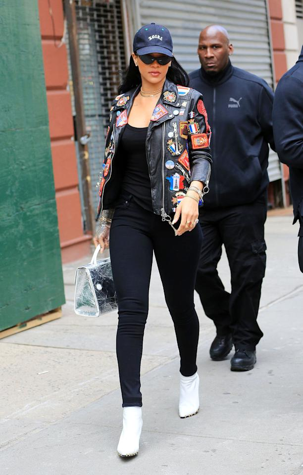 <p>RiRi stopped off in NYC in between stops on her ANTI Tour wearing a statement leather jacket with a black tee and jeans, accessorized with white booties, a baseball cap, and her Adam Selman x Le Specs sunglasses.</p>