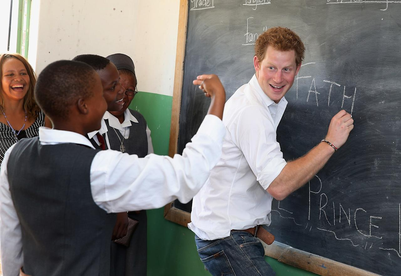 MASERU, LESOTHO - FEBRUARY 27:  Prince Harry  learns sign language as he visits Kananelo Centre for the deaf, a project supported by his charity Sentebale on February 27, 2013 in Maseru, Lesotho. Sentebale is a charity founded by Prince Harry and Prince Seeiso of Lesotho. It helps the most vulnerable children in Lesotho get the support they need to lead healthy and productive lives. Sentebale works with local grassroots organisations to help these children, the victims of extreme poverty and Lesotho's HIV/AIDS epidemic. Cathy Ferrier was appointed as Sentebale's Chief Executive in March 2012 and is spearheading a fundraising initiative to build the Mamohato Centre which will provide psychosocial support for children and young people infected with HIV. Prince Harry is due to pay a visit to Lesotho this week to catch up on his charity's progress and meet key children who will be supported by the charity.  (Photo by Chris Jackson/Getty Images)