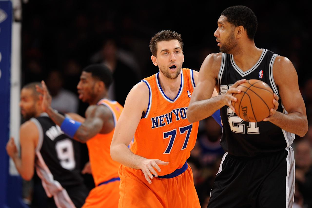 NEW YORK, NY - NOVEMBER 10: Tim Duncan #21 of the San Antonio Spurs looks for a pass around Andrea Bargnani #77 of the New York Knicks during the first half at Madison Square Garden on November 10, 2013 in New York City. The Spurs defeat the Knicks 120-89. NOTE TO USER: User expressly acknowledges and agrees that, by downloading and/or using this photograph, user is consenting to the terms and conditions of the Getty Images License Agreement. (Photo by Maddie Meyer/Getty Images)