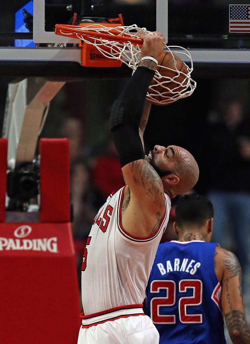The Los Angeles Lakers have acquired two-time all-star forward Carlos Boozer, shown January 24, 2014 in Chicago, Illinois, on amnesty waivers, the National Basketball team says