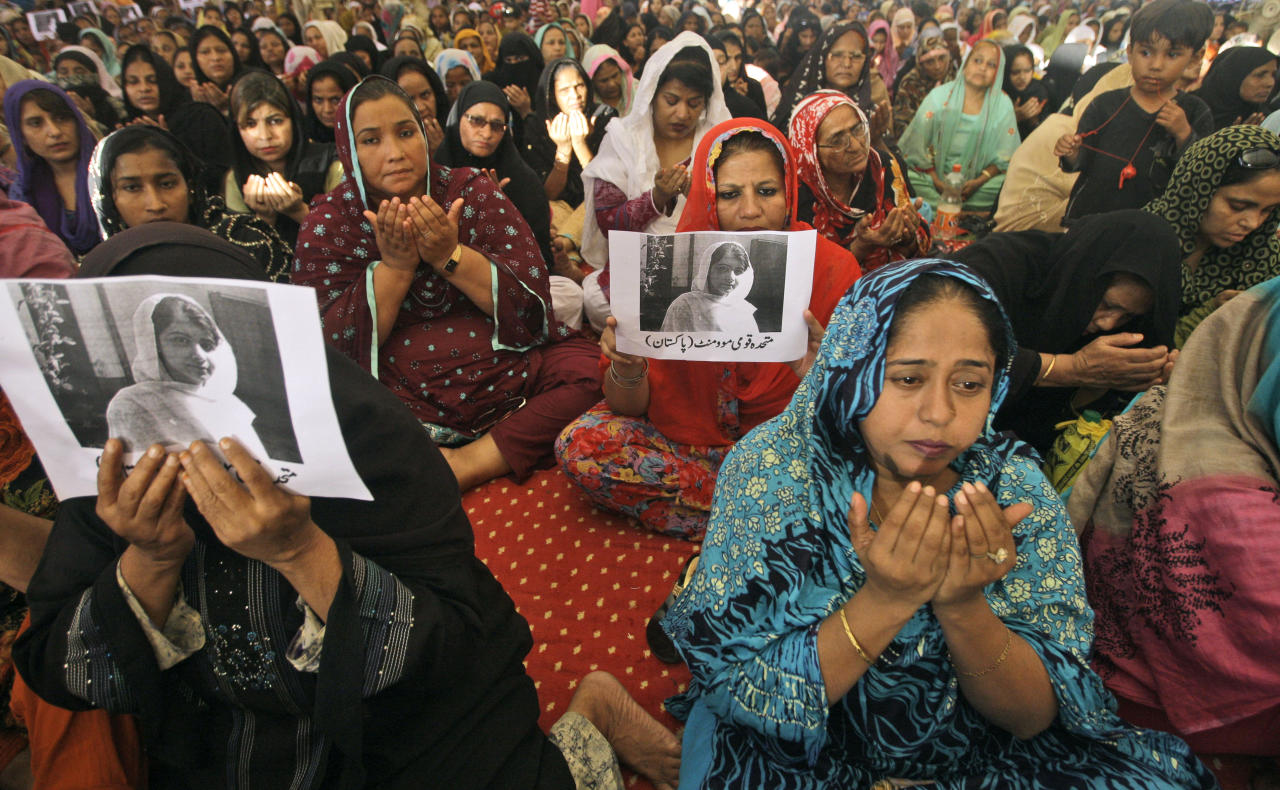 """Supporters of Pakistani political party Muttahida Qaumi Movement (MQM), chant prayers in support of 14-year-old schoolgirl Malala Yousufzai, who was shot on Tuesday by the Taliban for speaking out in support of education for women, at the (MQM)' headquarter in Karachi, Pakistan, Wednesday, Oct. 10, 2012. Pakistani doctors successfully removed a bullet Wednesday from the neck of a 14-year-old girl who was shot by the Taliban for speaking out in support of education for women, a government minister said. Writing on the poster under Malala's picture read, """" Muttahida Qaumi Movement, Pakistan.""""(AP Photo/Shakil Adil)"""
