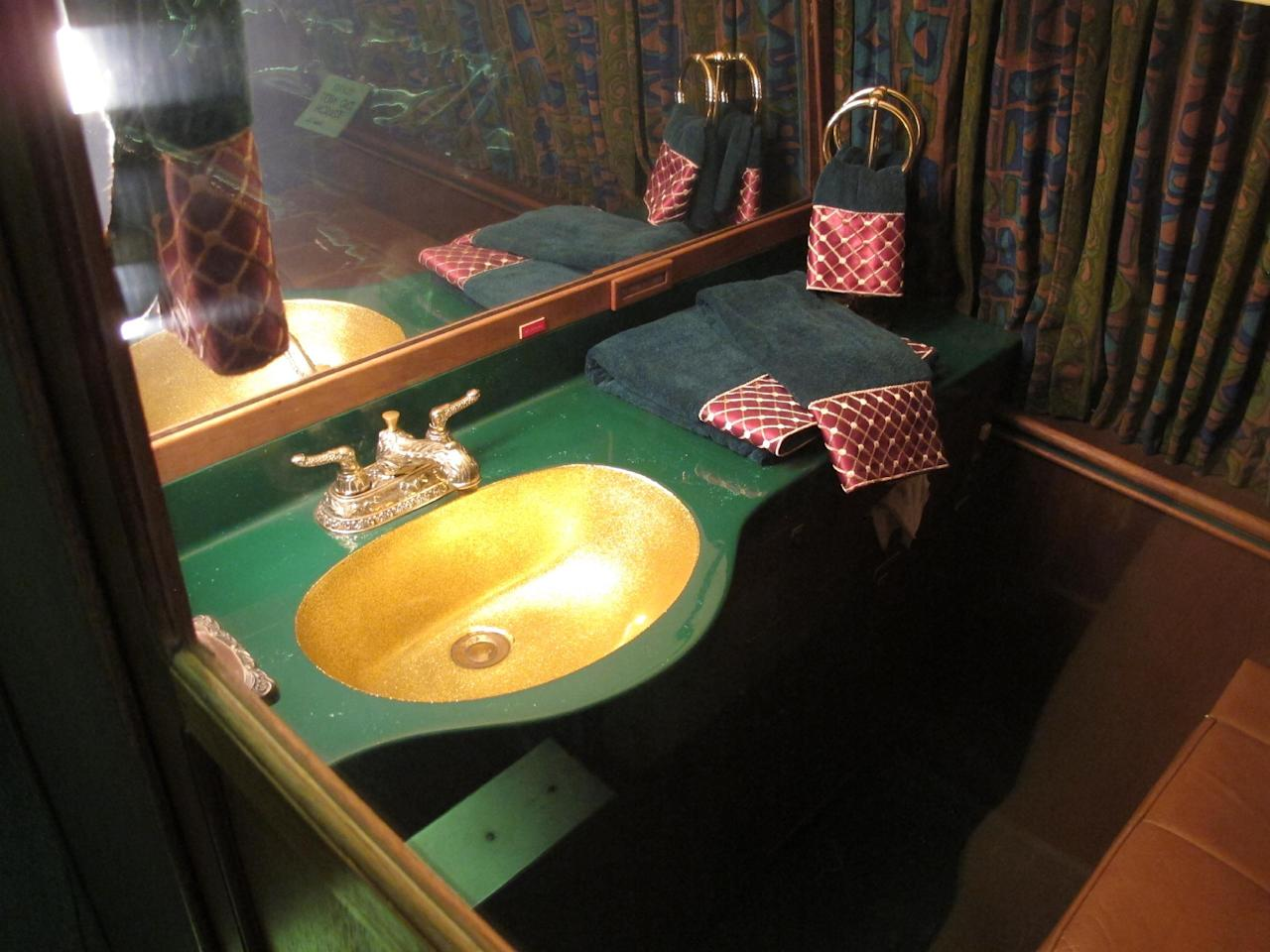 This photo taken on Tuesday, July 1, 2014, shows the bathroom inside the Lisa Marie, one of two jets once owned by late singer Elvis Presley, that are used as tourist exhibits at the Graceland attraction in Memphis, Tenn. The company that operates the Graceland tourist attraction has told the current owners of the Lisa Marie, and another plane called the Hound Dog II, that it wants the planes removed from Graceland by late April 2015, or shortly afterward. (AP Photo/Adrian Sainz)