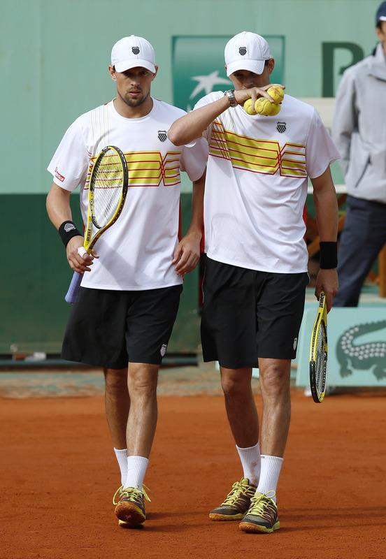 US Bob Bryan (down) and US Mike Bryan (R) hit a return to to Belarus Max Mirnyi and Canada's Daniel Nestor during Men's Doubles final tennis match of the French Open tennis tournament at the Roland Garros stadium, on June 9, 2012 in Paris.  AFP PHOTO / THOMAS COEXTHOMAS COEX/AFP/GettyImages
