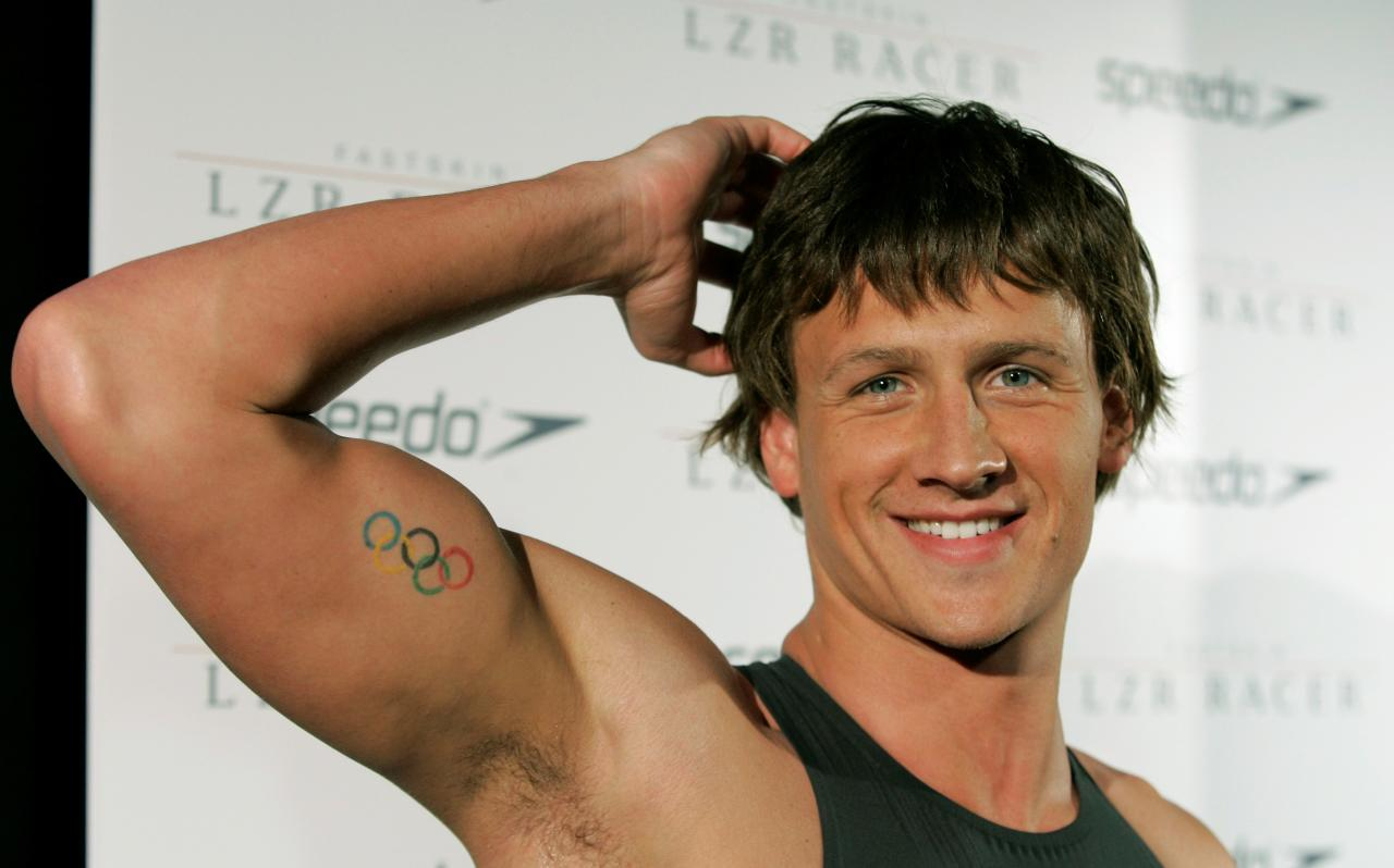 Olympic medalist Ryan Lochte shows off his Olympic rings tattoo on his right bicep while wearing a new Speedo high technology swimsuit during the swimsuit's debut at a news conference in New York, Tuesday, Feb. 12, 2008.  (AP Photo/Kathy Willens)