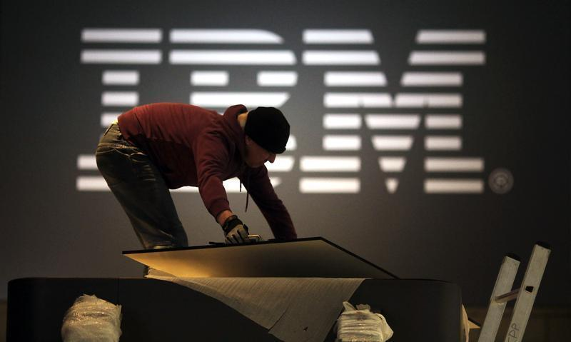 A worker prepares a stand of IBM for the upcoming CeBIT fair inside a hall in Hanover