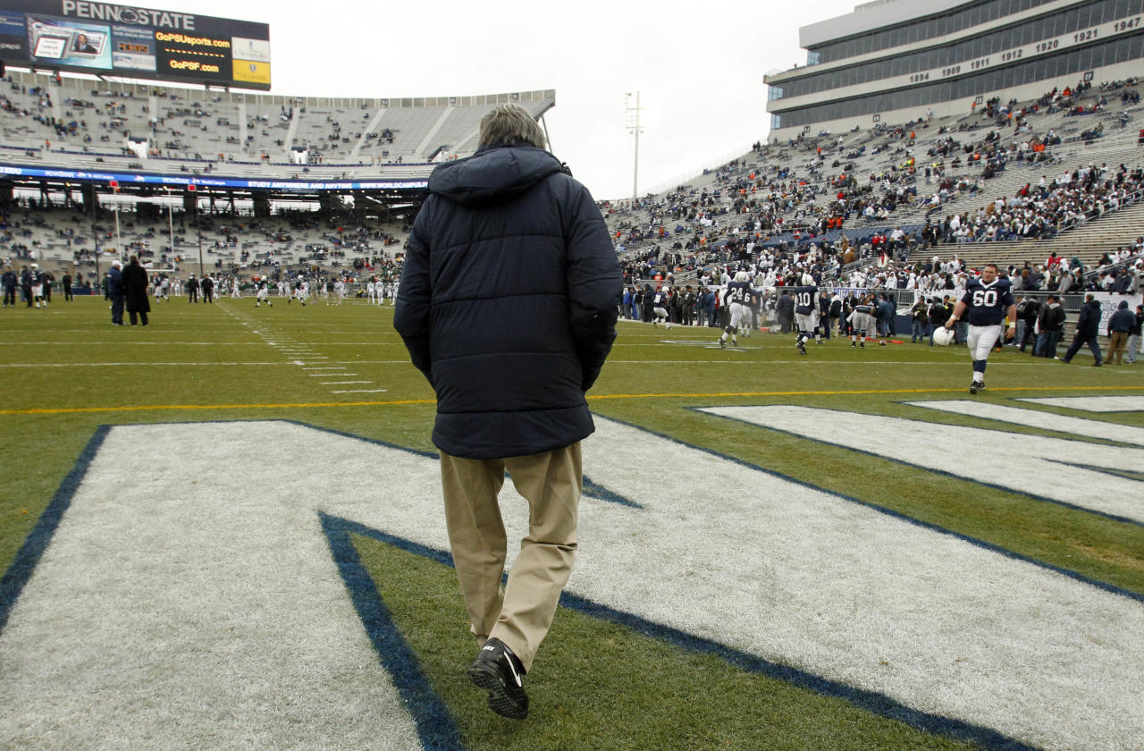 FILE - In this Nov. 27, 2010, file photo, Penn State coach Joe Paterno walks on to the field at Beaver Stadium for warm ups before an NCAA college football game against Michigan State in State College, Pa. Paterno, who preached success with honor for half a century but whose legend was shattered by a child sex abuse scandal, said Wednesdaym Nov. 9, 2011, the he will retire at the end of this season. (AP Photo/Gene J. Puskar, File)