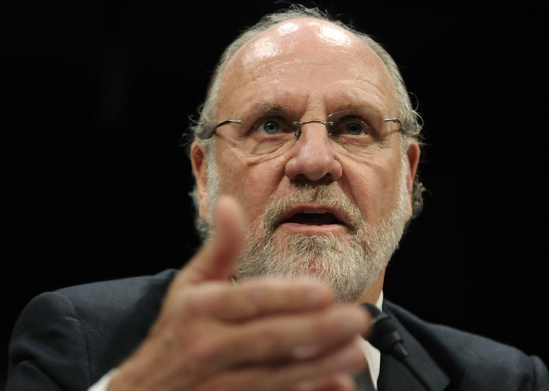 Corzine gestures as he testifies before a House Financial Services Committee Oversight and Investigations Subcommittee hearing on the collapse of MF Global, at the U.S. Capitol in Washington