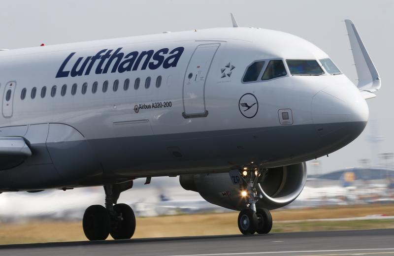 """A Lufthansa Airbus A 320 takes off on runway """"Startbahn West"""" at Frankfurt airport"""